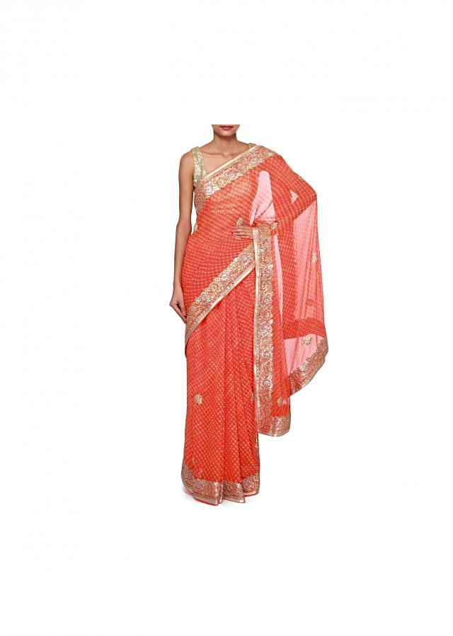 Orange leheriya saree adorn in gotta patch border only on Kalki
