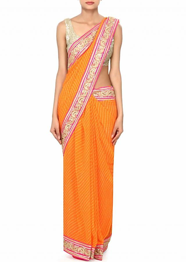 Orange leheriya saree embellished in zari and sequin embroidery only on Kalki