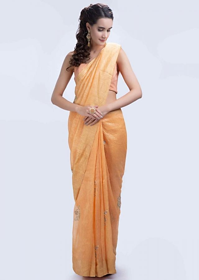 Orange linen saree with embroidered butti only on Kalki