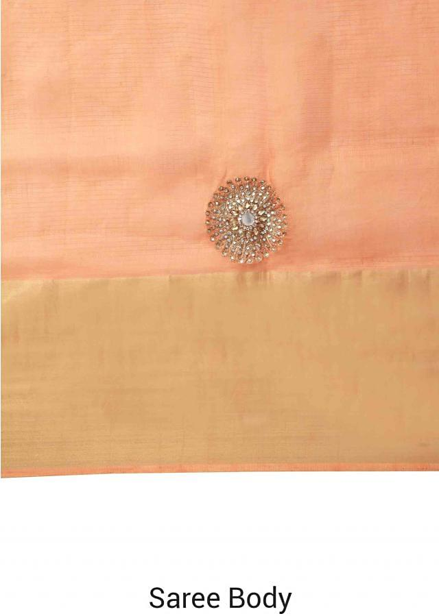 Orange saree adorn in embroidered butti all over only on Kalki