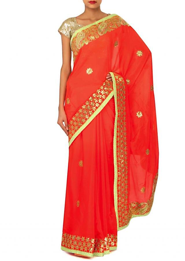 Orange Saree With Gotta Patch Embroidered Border Online - Kalki Fashion