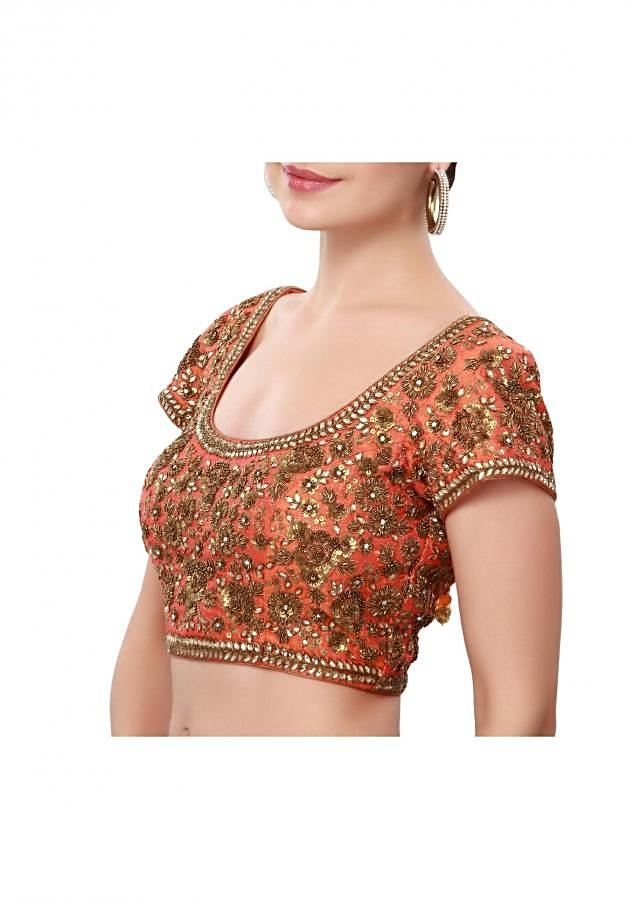 Orange saree adorn in kundan and sequin embroidery only on Kalki