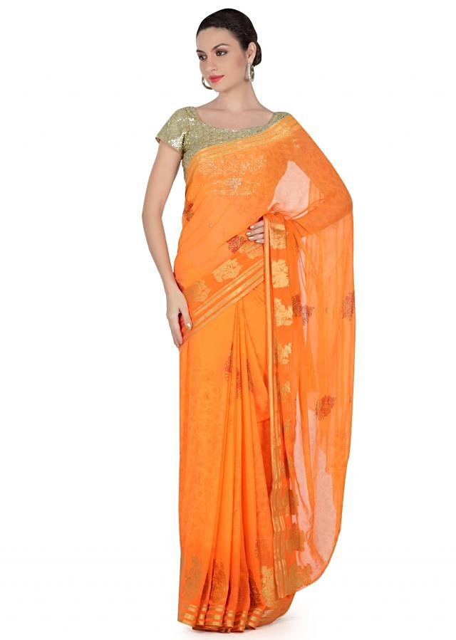 Orange saree adorn in printed and weave butti only on Kalki