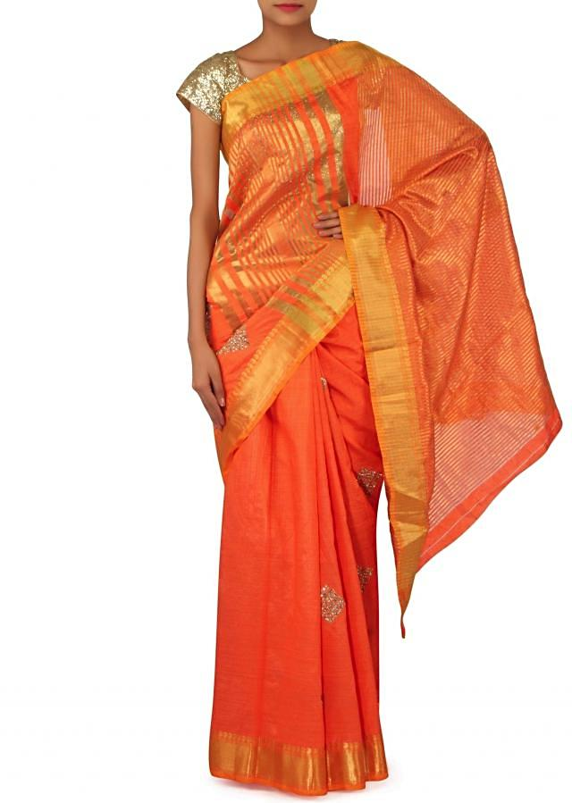 Orange saree enhanced in kundan butt in square motif only on Kalki