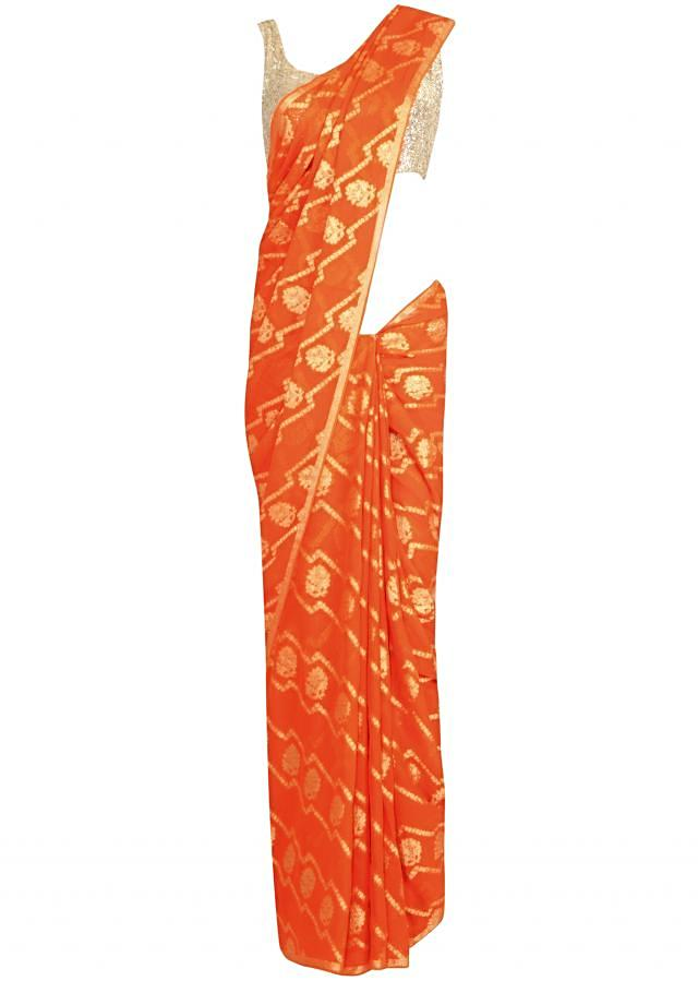 Orange saree enhanced in weaved embroidery only on Kalki