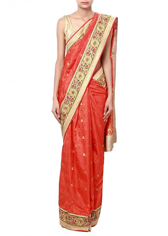 Orange saree featuring in cut work zari border only on Kalki
