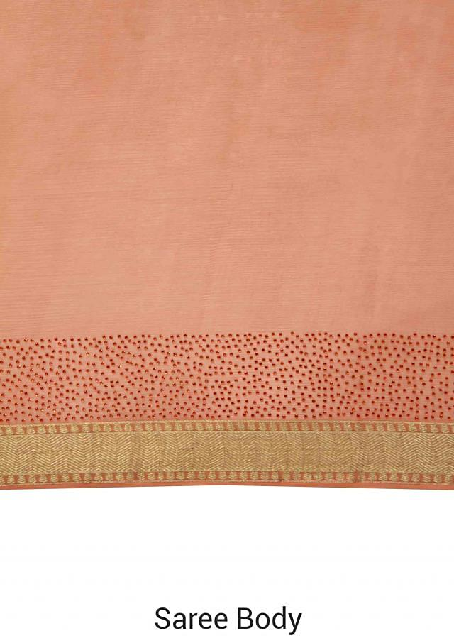 Orange saree highlighted in kundan border only on Kalki