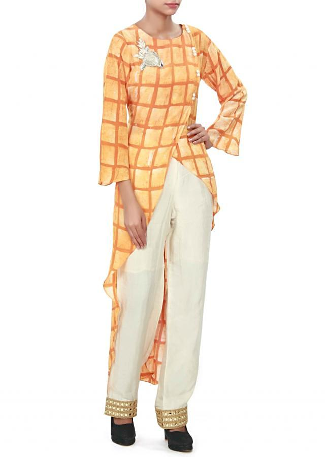 Orange straight suit featuring with embroidered butti only on Kalki