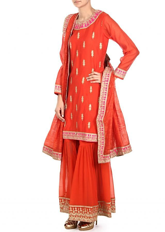 Orange suit adorn in zari embroidered butti only on Kalki