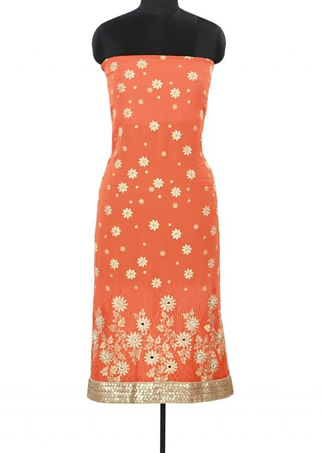 Orange unstitched suit adorn in resham and sequin embroidery only on Kalki