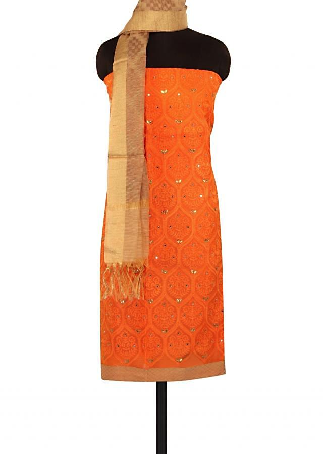 Orange unstitched suit adorn in thread embroidery only on Kalki