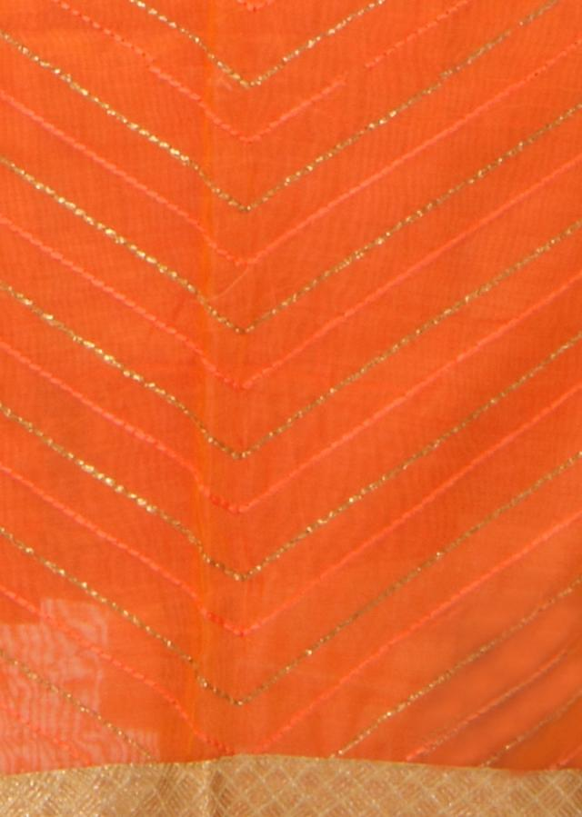 Orange unstitched suit embellished in resham and zari only on Kalki