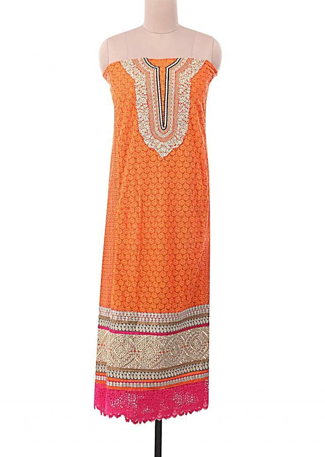 Orange unstitched suit embellished in zari and thread embroidery only on Kalki