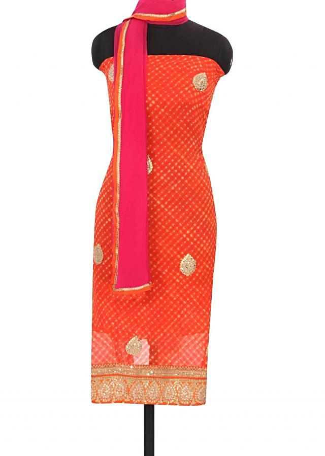 Orange unstitched suit in leheriya and gotta work only on Kalki