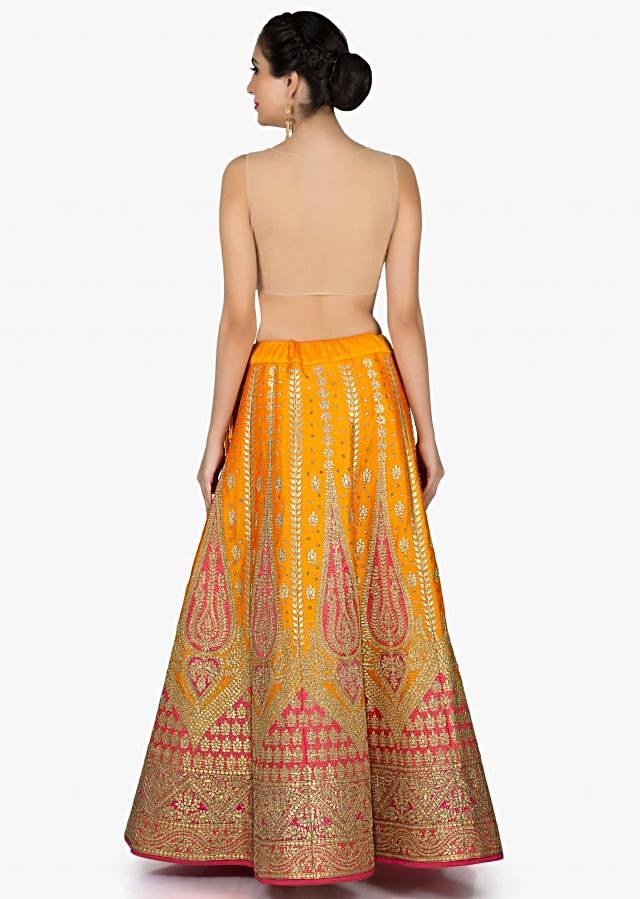 Orange and pink lehenga in raw silk with gotta patch embroidery only on Kalki