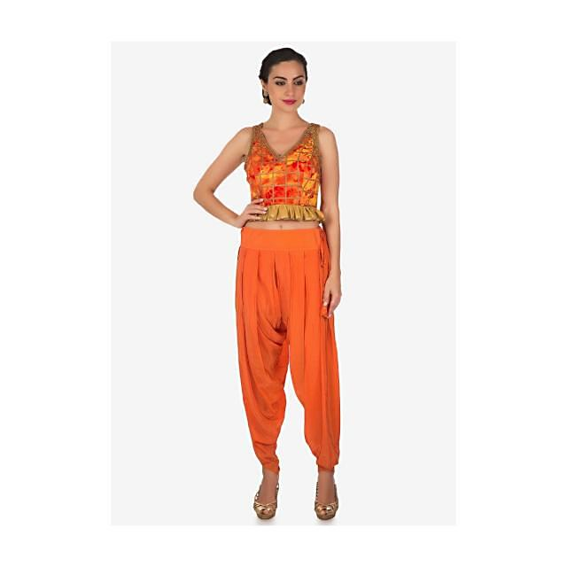 Orange dhoti pants with crop top blouse in kundan embroidery only on Kalki