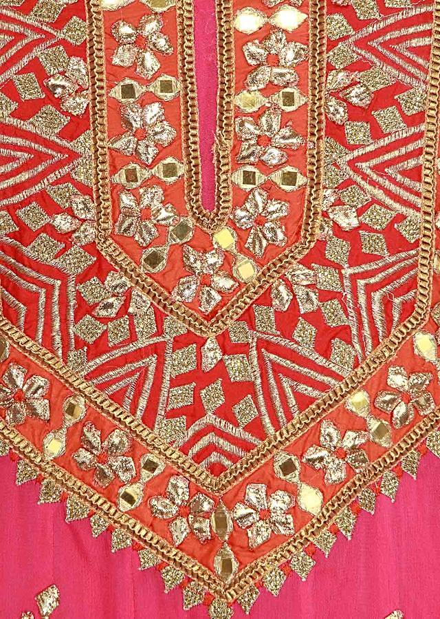 orange semi stitched suit adorn in pearl and resham work only on Kalki