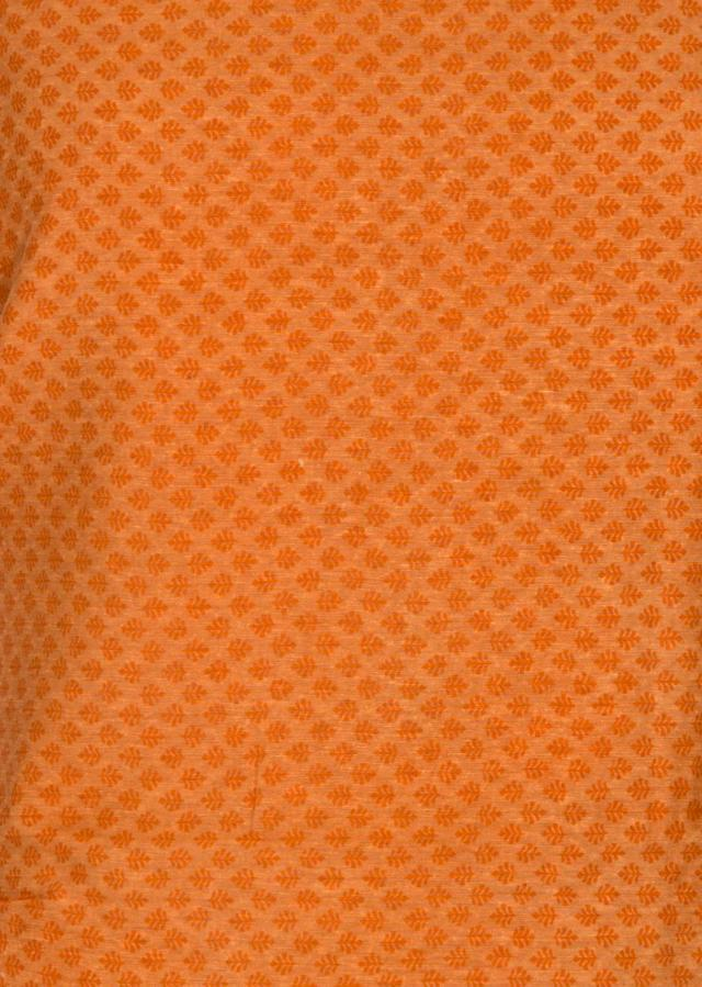 Orange unstitched suit featuring the self print only on Kalki