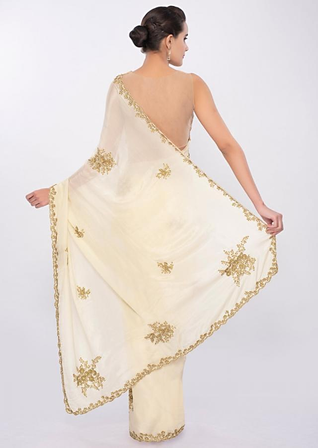 Pale lemon yellow chiffon saree in cut dana and sequins embroidered butti and border only on Kalki