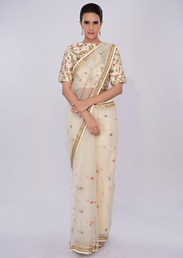 Pale Lemon Yellow Net Saree With Floral Embroidery And Butti Online - Kalki Fashion