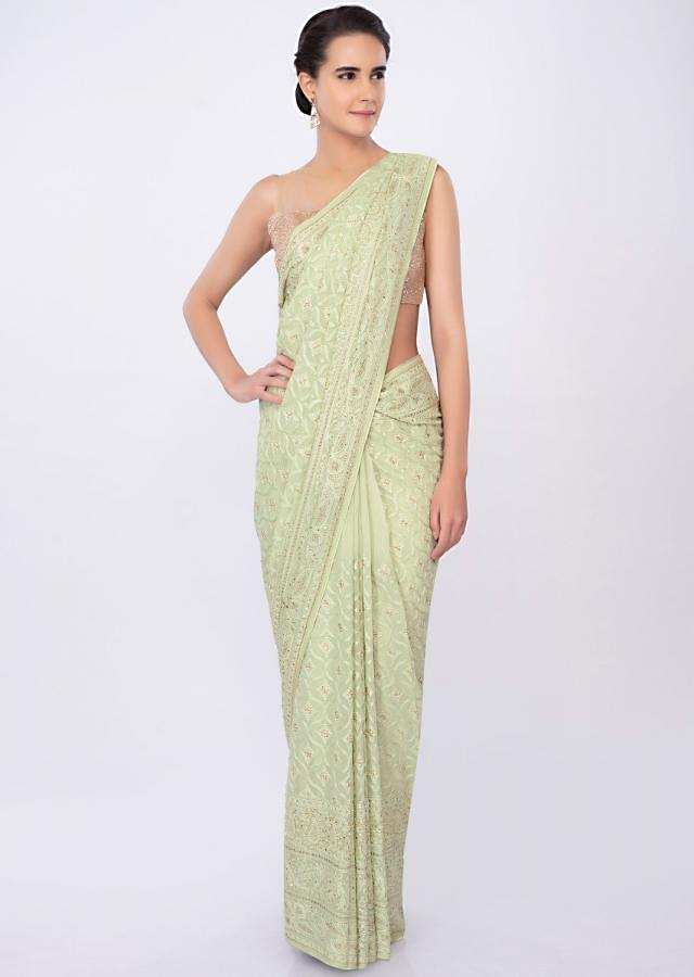 Paris green georgette saree in lucknowi embroidery  only on kalki