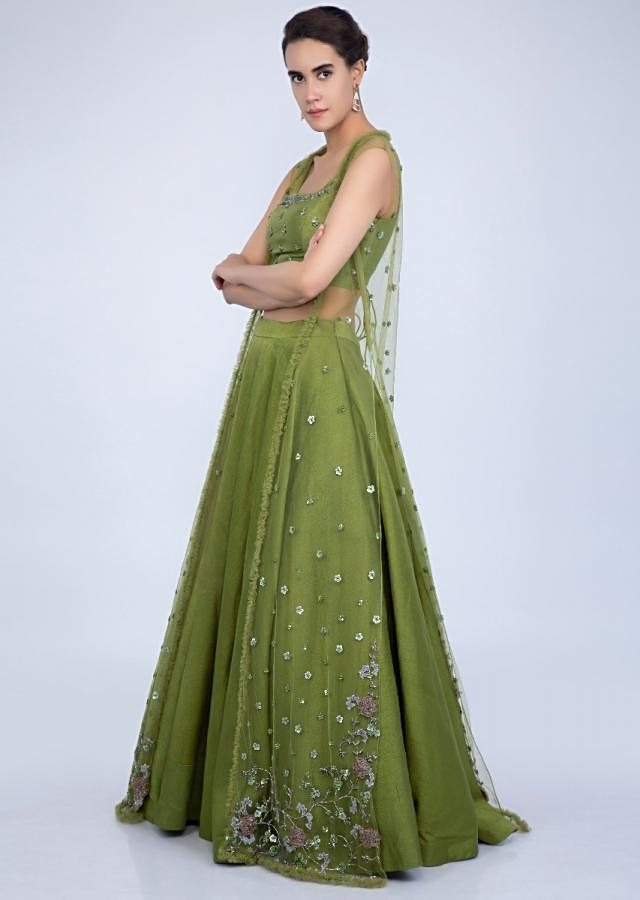 Niti Taylor in Kalki Parrot Green Lehenga And Crop Top In Raw Silk With A Matching Heavy Embroidered Long Jacket