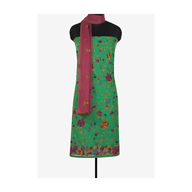 Parrot green unstitched suit in resham floral embroidery in jaal motif only on Kalki