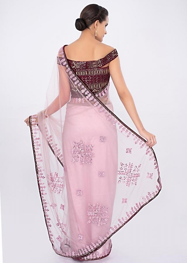 Pastel pink draped net saree with plum raw silk off shoulder blouse only on kalki