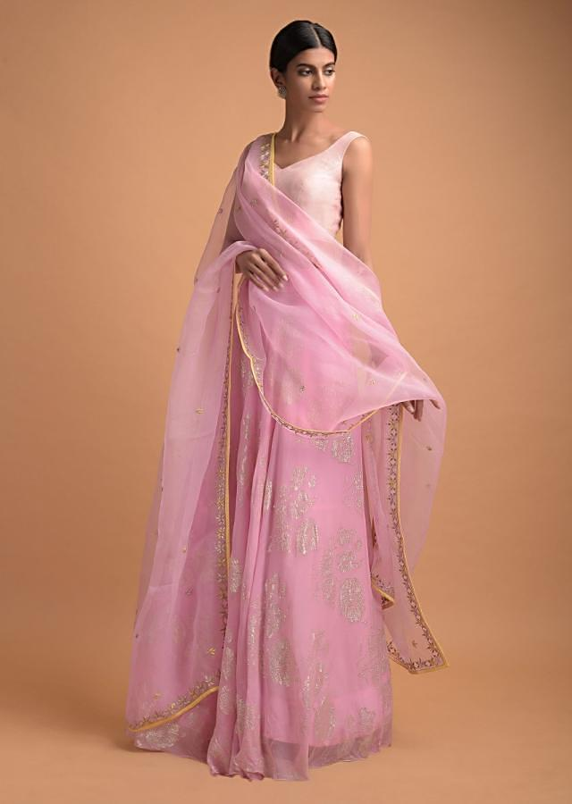 Pastel Pink Skirt And Crop Top With Weaved Floral Pattern And Badla Work Online - Kalki Fashion