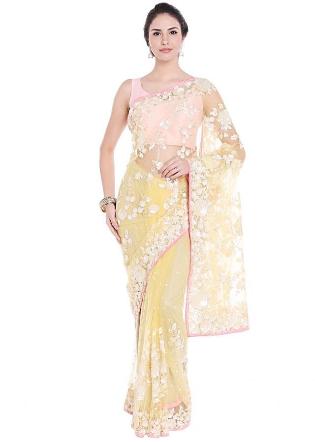 Pastel yellow saree in white sequin embroidery only on Kalki