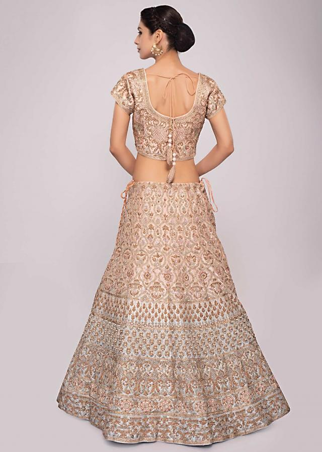 Peach and blue shaded raw silk lehenga paired with matching embroidered blouse and net dupatta only on Kalki