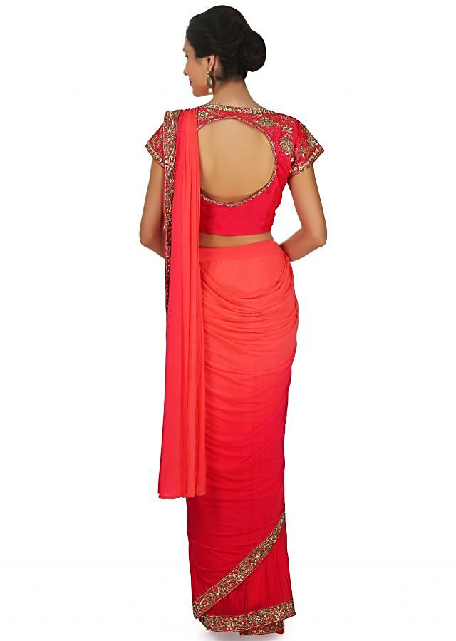 Peach and coral pre stitched saree with coral ready embroidered blouse only on Kalki