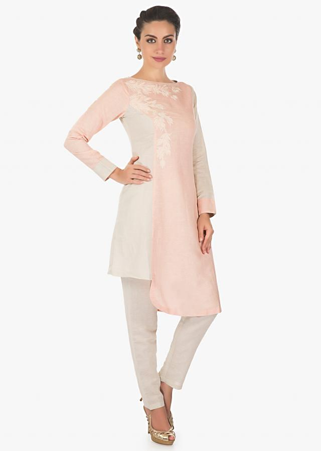 Peach and cream cotton kurti matched with cream pant embellished with cut dana and resham embroidery only in kalki