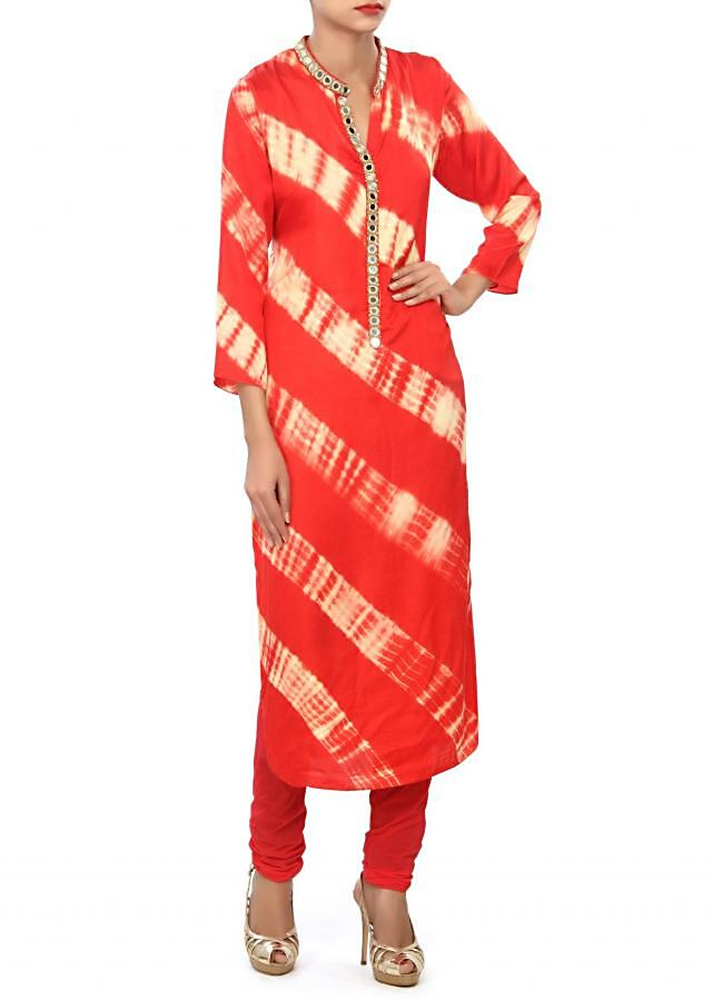 Peach and cream kurti embellished in mirror and zari embroidery only on Kalki