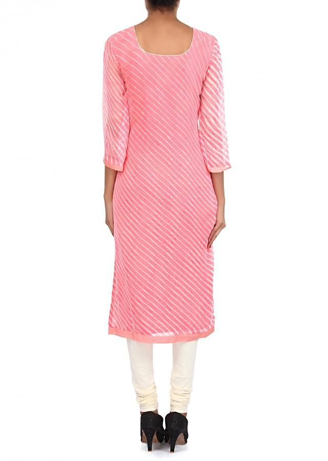 Peach and cream suit adorn in zari and gathers embroidery only on Kalki