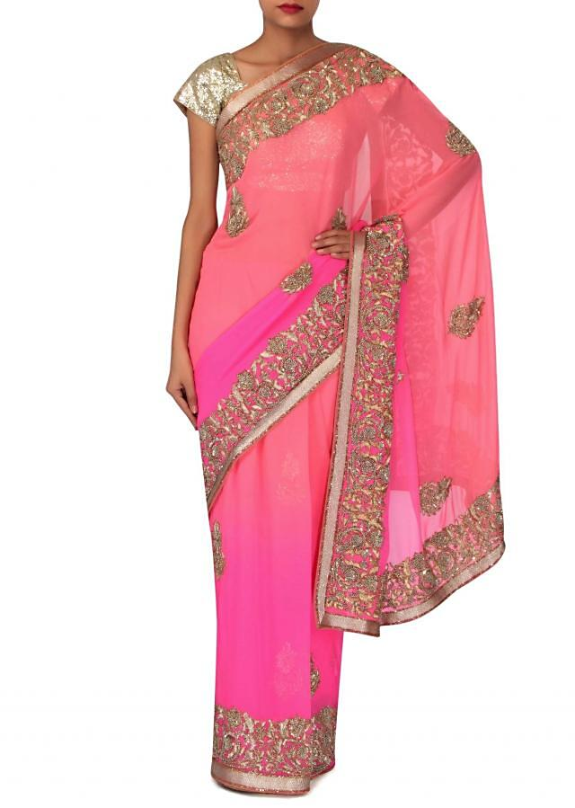 Peachy pink shaded saree embellished in french knot embroidery only on Kalki