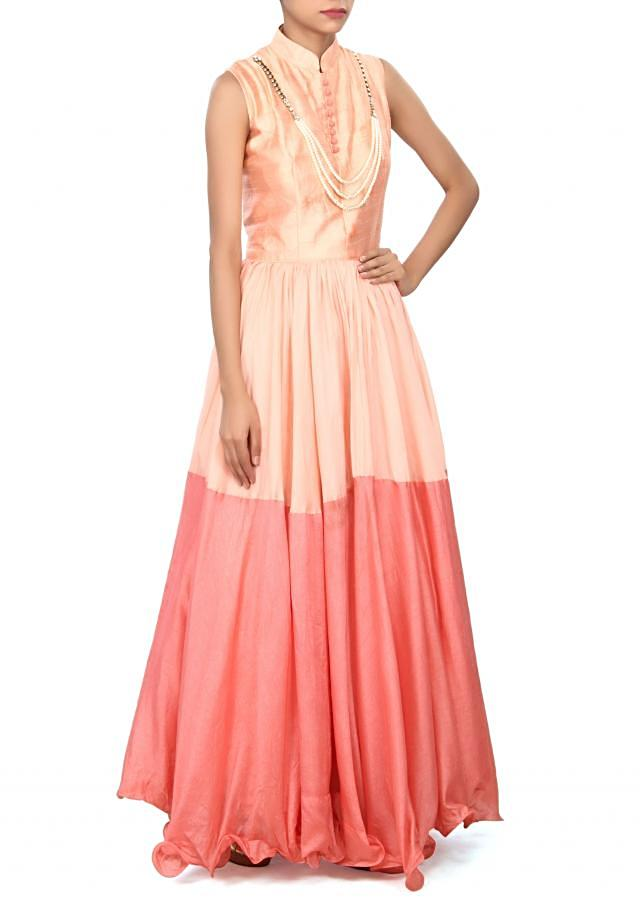 Peach and pink suit adorn in pearl necklace only on Kalki