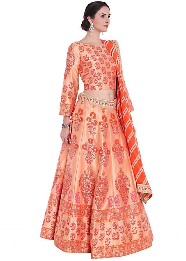 Peach and rust lehenga in floral print highlighted in sequin and gotta only on Kalki