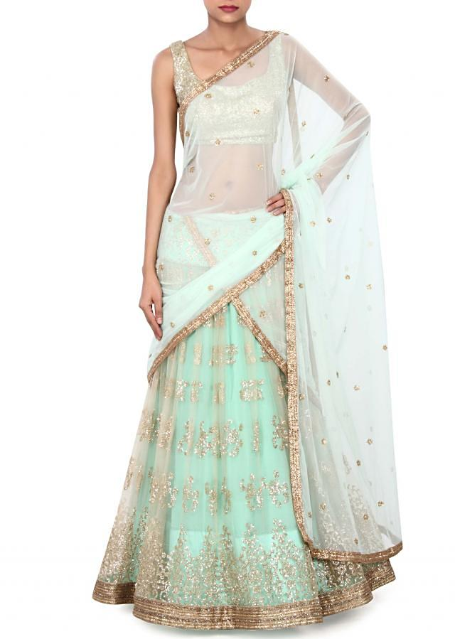 Peach and turq lehenga adorn in shimmer only on Kalki