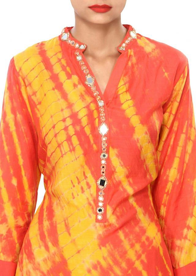 Peach and yellow kurti embellished in mirror and zari embroidery only on Kalki