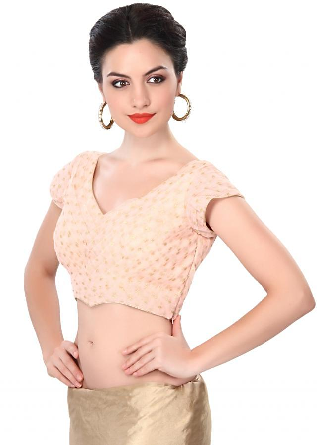 Peach blouse adorn in pleats only on Kalki
