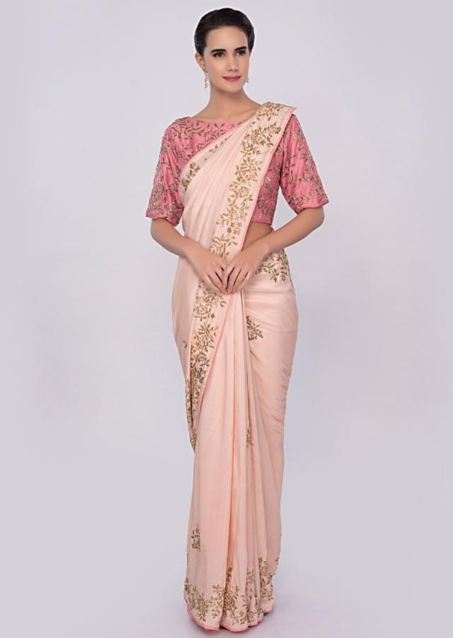Peach cut dana embroidered saree with contrasting punch pink blouse only on Kalki
