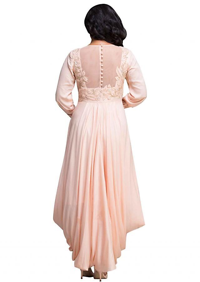 Peach dress features in applique and cowl drape
