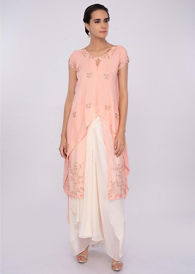 Peach Top With Fancy Layers And Off White Skirt In Pleats Online - Kalki Fashion