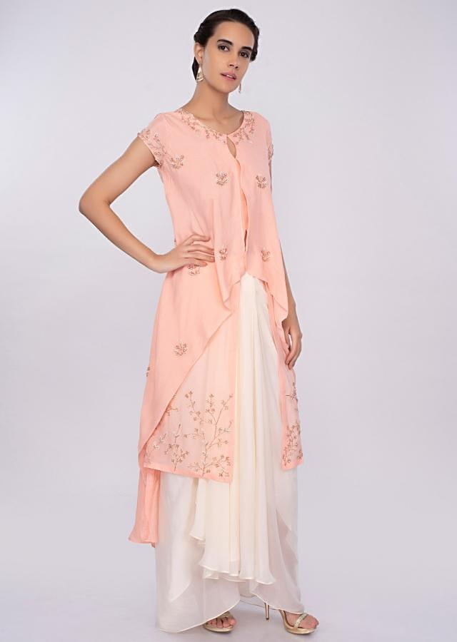 Peach fancy layered top with off white skirt in pleats only on kalki
