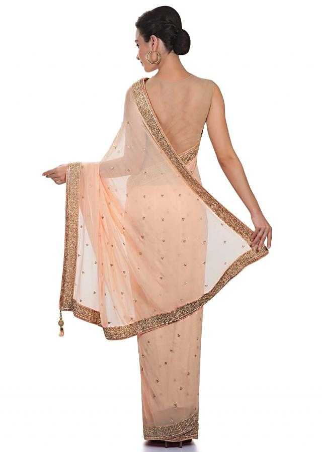 Peach georgette saree crafted with kundan and zardosi work only on Kalki