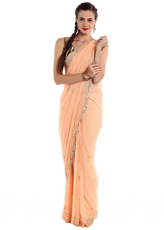 Peach georgette saree designed with cut dana work and tassels only on Kalki