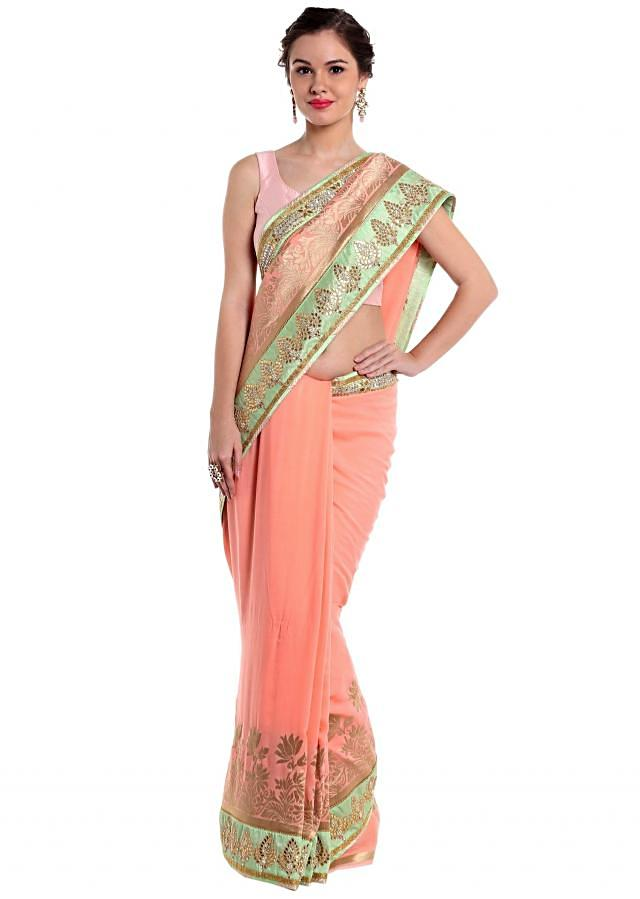 Peach georgette saree designed with gotta patch work  only on Kalki