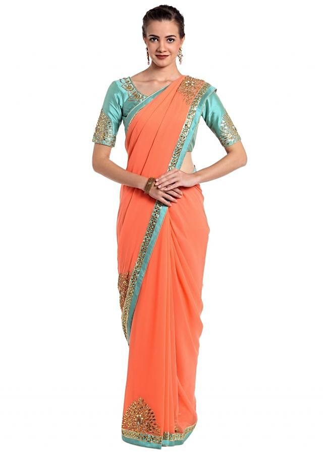 Peach georgette saree with carnal blue piping only on Kalki