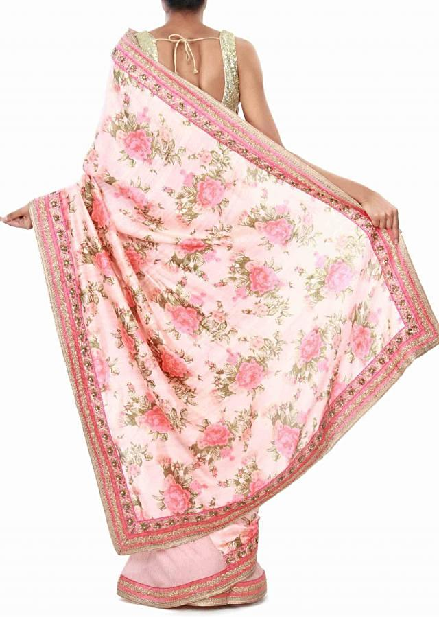 Peach half and half saree enhanced in print and embroidered border only on Kalki